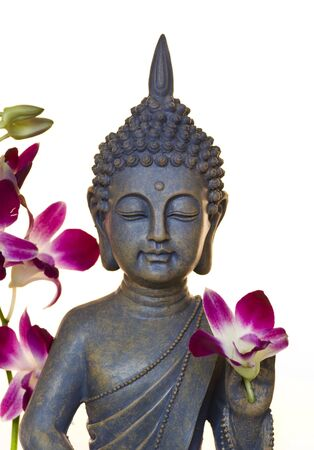 zen like: Buddha statue and orchid flower