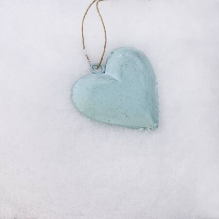turquoise heart in the snow Stock Photo - 6550586