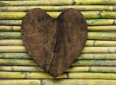 wooden heart on bamboo sticks Stock Photo - 6550635