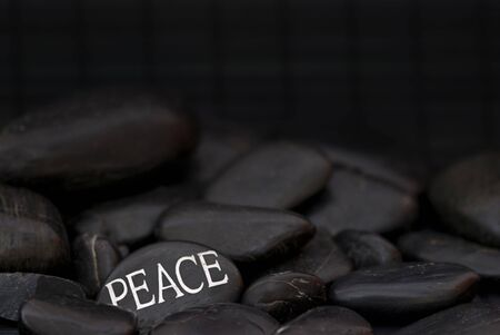 black pebble with engraved message peace Stock Photo - 6550588