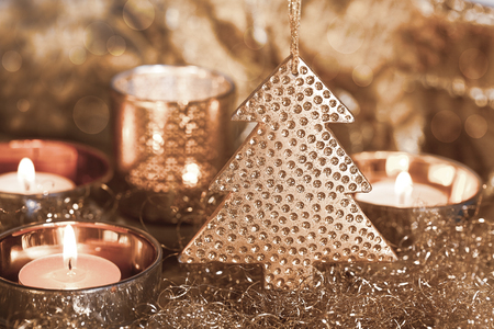 Elegant christmas decoration and candles copper colored, perfect for christmas cards and holiday decoration