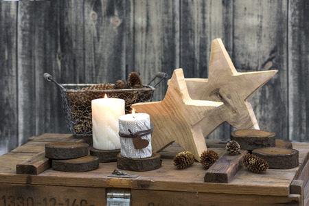 Rustic Christmas still life with candles on old wooden crate