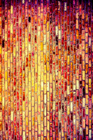Vintage brick wall with some stones in it, abstract architecture background