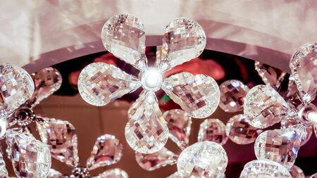beautiful lamp with brillliant flowers with five petals shine inside, not alive flowers in luxure big chandalier shine like a brilliant
