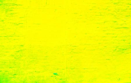 yellow green bright juicy big brick wall with paint on it and peeps brick texture with horizontal and diagonal bricks. Colorful brick wall pattern, painted bricks as urban texture Stock Photo