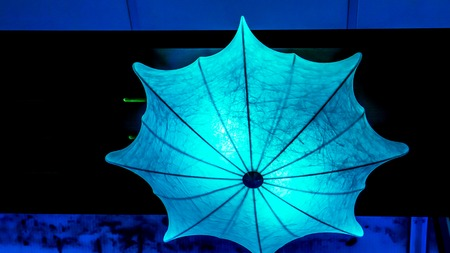 Lighting umbrella shape from small lamps at night