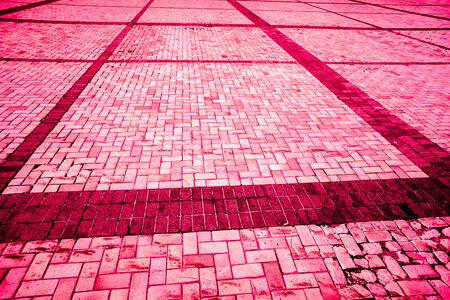 part of strong burgundy bloody diagonal layed pavement tiles with black horizontal and vertical lines, paving stone with light and dark color as texture Stock Photo