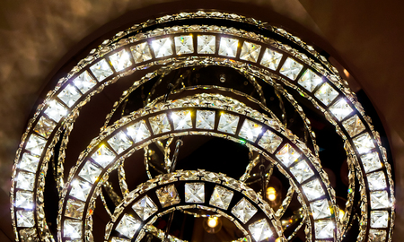 bright three circles one bigger than another with crystal clean stones with shine and light inside big luxury modern lamp. bright crystal diamond chandelier with luxury design