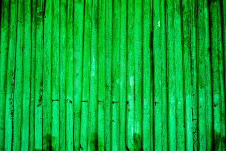 rundown: dark green emerald vertical old wooden planks with parts of cracked paint and natural wooden texture, knots and spots. vintage wooden planks as background Stock Photo