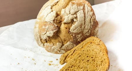 peaces of Homemade bread lay against white background