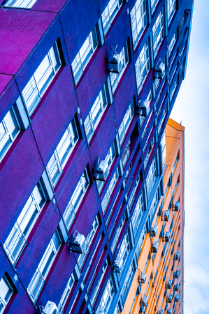 storey: Colourful multi-storey residential building Stock Photo