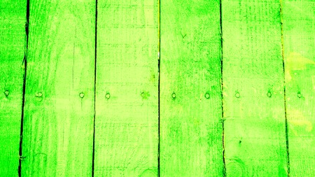 vertical wooden planks with screws in the middle of every plank toned to emerald green azure color as background. texture of old wooden planks with cracked and smeared paint Stock Photo