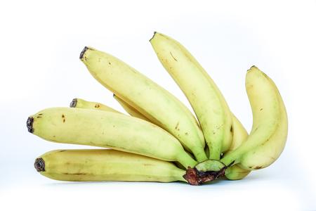 banana skin: back view to black bananas tips on yellow sunny banana ripes. Bunch of bananas isolated on white background. eight sweet organic fresh bananas in one big brunch. Stock Photo
