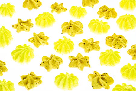 golden yellow stars. Many sweet zephyrs pattern background. Trendy top view dessert image. Bakery products top view. Colorful cookies background. stars and flowers meringues lay one by one.