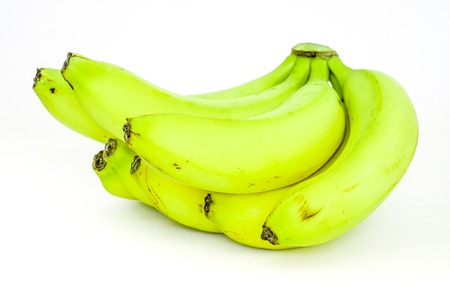 banana skin: side view to black bananas tips on yellow sunny banana ripes. Bunch of bananas isolated on white background. eight sweet organic fresh bananas in one big brunch.
