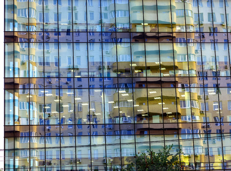 background of window reflection with lights and house. steel light blue background of glass high rise building skyscraper commercial modern city. Business concept of successful industrial architecture Stock Photo