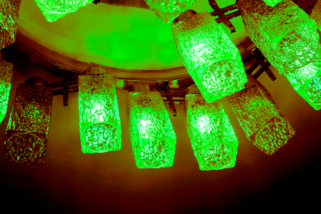 top view to part of round decorative modern shaped lamps on ceiling against dark background