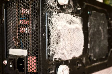 grey dust on the computer pc processor cooler with mainboard and computer case fragment Фото со стока