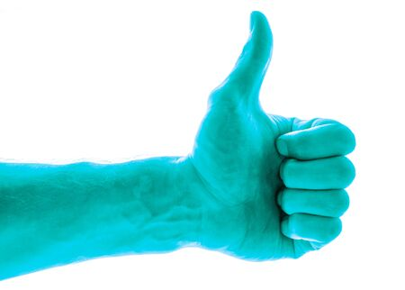Like concept. Voting hand on blue background. One hand making thumb up gesture.