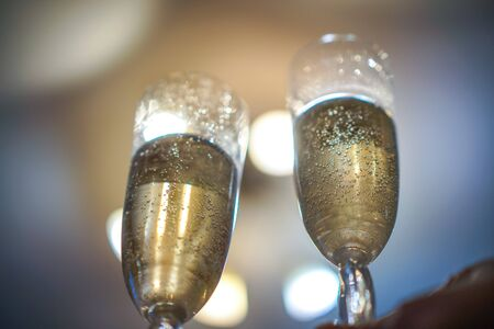 two long glass glasses with champaign and bubbles inside Stock Photo