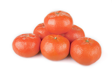 Bright orange mandarins piled up on a white surface. Mandarins isolated on white background. Stok Fotoğraf