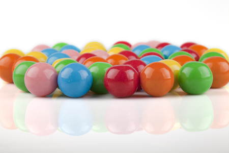 gumballs: Multicolored gumballs on a white surface. Bubble gums isolated on white background.