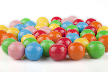 gumballs: Multicolored gumball on a white surface. Bubble gums isolated on white background.