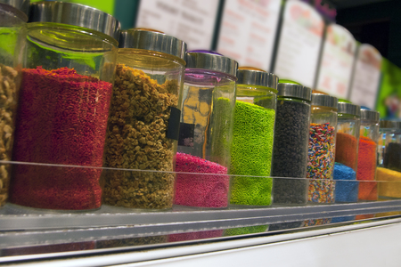 Colorful sprinkles at the ice cream parlour. Stock Photo