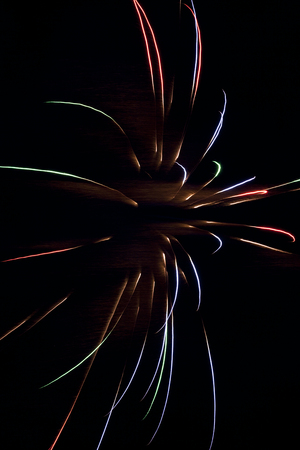 Colorful fireworks against a pitch black sky.