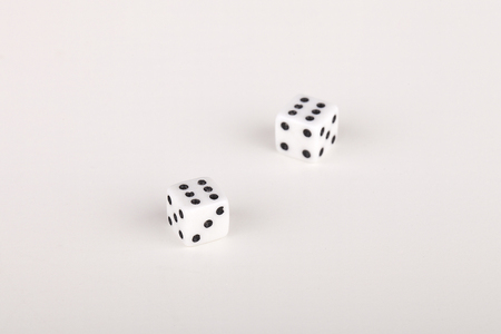 A pair of six on a roll of the dice on a white surface. Dice isolated on white background.