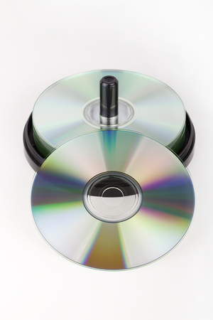 Pack of DVDs on a white surface. Stack of DVDs isolated on white background.