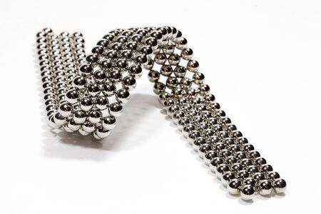 Magnetic beads isolated on a white background.