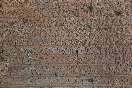 gritty: Abstract background reddish gritty concrete texture.