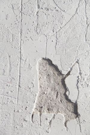 Abstract white damaged plaster background gritty texture.