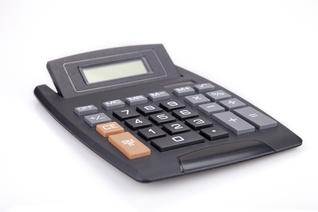 Black calculator on a white surface. Black calculator isolated on white background. Imagens
