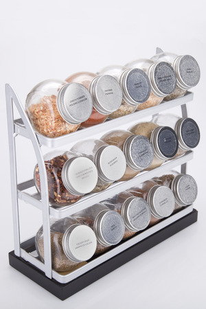 Spices shelves on a white surface. Spice rack isolated on white background.