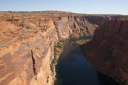 Colorado river and red rock cliffs at Glen Canyon Dam, Arizona, USA. Imagens - 84725803