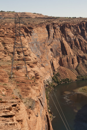 Pylon on a red rock cliff by the Colorado river at Glen Canyon Dam, Page, Arizona.
