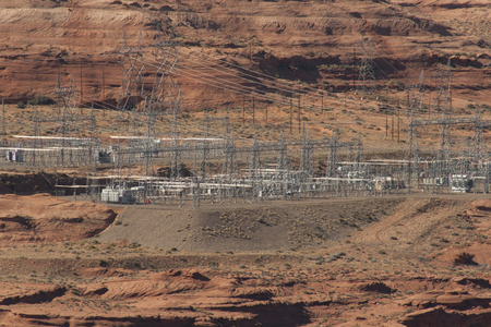 Electric substation on a red rock cliff of Glen Canyon Dam at Page, Arizona. Imagens - 84725818