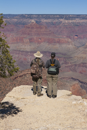 A pair of adventurers standing at the Grand Canyon national park, Arizona, USA.