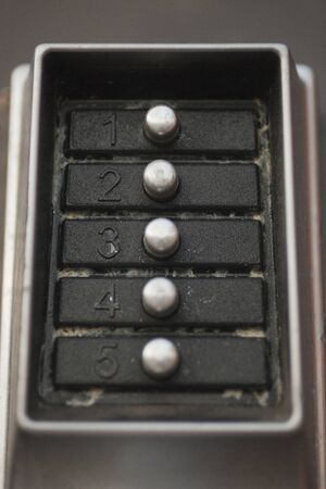 Close up of a dirty door lock metal keypad. Macro view of the buttons and digits of a doorlock keypad. Imagens