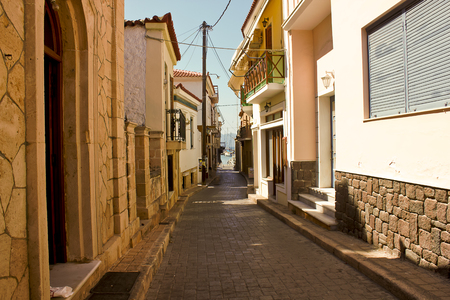 The road which leads to the port, Aegina town, Aegina Island, Greece Stock Photo
