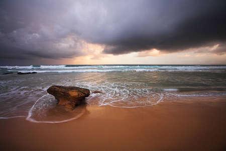 Stormy sky over Beares Beach Bermagui NSW Stock Photo - 12582154