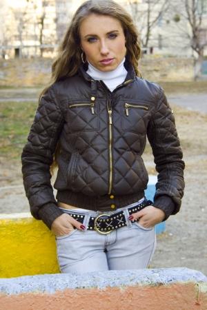 Beautiful model with long hair in urban style Standard-Bild