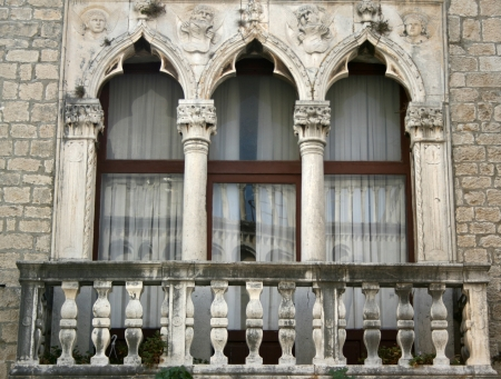 Window of big palazzo Cipico in Trogir, Croatia