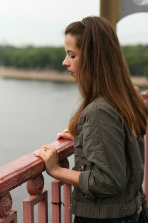 Depression girl on the bridge Stock Photo - 15317001