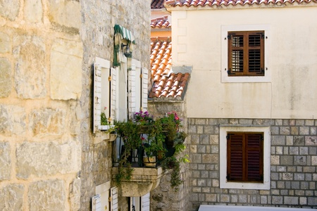 Windows and balcony in old houses in Budva, Montenegro photo