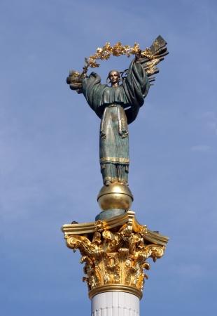 maidan: Famous statue on a column in Kyev, Ukraine. Beregynia stands on Maidan Nezalezhnosti (Independence Square) as a symbol of Ukrainian freedom