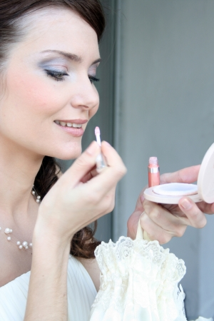 Bride getting her makeup done photo