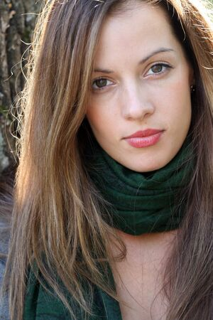 Portrait of young brunette woman in green scarf. Stock Photo - 15631457